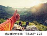 happy male traveler showing... | Shutterstock . vector #451694128