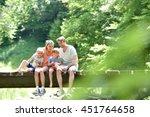 Family Sitting On A Bridge...