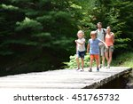 family of four walking on a... | Shutterstock . vector #451765732