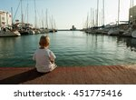 little boy sits alone in the... | Shutterstock . vector #451775416