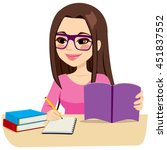 teenage girl studying with some ... | Shutterstock .eps vector #451837552