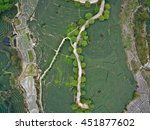 Small photo of Aerial photography at Spring mountain tea garden landscape with winding road