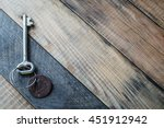 Old Metal Key With Keychain On...