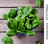 baby spinach in a blue ceramic... | Shutterstock . vector #451970662