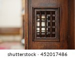 Wooden Window Of Confessional...
