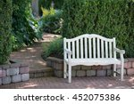 a whitewashed bench sits near a ... | Shutterstock . vector #452075386