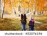 laughing brother and sister... | Shutterstock . vector #452076196