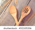 Two Wooden Spoons In A Rustic...