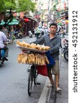 Small photo of Hanoi VIetnam July 13 2016 Street vendors in Hanoi's Old Quarter.They sell abread in Hanoi,Vietnam in early morning