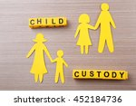 paper family on wooden table.... | Shutterstock . vector #452184736