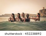 enjoying time in the water | Shutterstock . vector #452238892