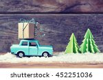 toy car carrying a christmas... | Shutterstock . vector #452251036
