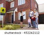 realtor outside house for sale... | Shutterstock . vector #452262112