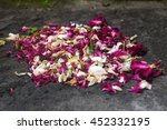 Small photo of withered hindu offering flowers on stone close up - all is impermanent