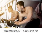 young man on bikes in a fitness ... | Shutterstock . vector #452354572