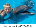 happy child and dolphins in... | Shutterstock . vector #452362396
