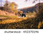 Family Walking Through Autumn...