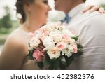 bride and groom holding... | Shutterstock . vector #452382376