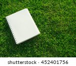 note book on grass with copy... | Shutterstock . vector #452401756
