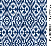 Seamless pattern Tribal Art Ikat Ogee in traditional classic blue and white colors. Boho style. | Shutterstock vector #452404432