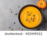 pumpkin cream soup with pumpkin ... | Shutterstock . vector #452449312