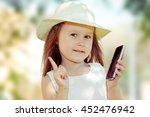 kid with smartphone. closeup... | Shutterstock . vector #452476942