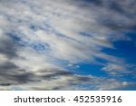 Small photo of Ethereal middle level altocumulus and altostratus on a cool sunny afternoon in winter are contrasted against the blue Australian sky.
