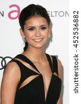 Small photo of Hollywood, CA, USA; February 25, 2013; Nina Dobrev arrives to the 20th Annual Elton John AIDS Foundation Academy Awards Viewing Party.