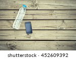water bottle with phone on wood ... | Shutterstock . vector #452609392