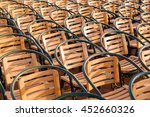 Small photo of Wooden chairs. Empty stools without people. Concept photo - absence of audience.