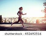 smiling female jogger training... | Shutterstock . vector #452692516