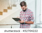 young casual businesman working ... | Shutterstock . vector #452704222