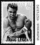 Small photo of MONACO - CIRCA 2014: A postage stamp printed in Vienna Austria portraying an image of Muhammad Ali when he knocked out Sony Liston during a boxing match in 1964, circa 2006
