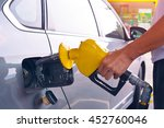 hand holding fuel nozzle to add ...   Shutterstock . vector #452760046