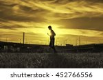 silhouette of a jogger at... | Shutterstock . vector #452766556