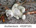 Old Stuffed Teddy Bear Laying...