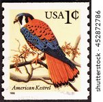 Small photo of Milan, Italy - July 14, 2016: American kestrel on american postage stamp