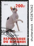 """Small photo of Republic of Burundi, - CIRCA 2010: A stamp printed by Burundi shows the a series of images """"Cat Breeds"""",circa 2010"""