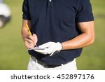 Midsection Of Golfer Writing O...