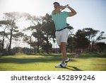 Full Length Of Handsome Golfer...
