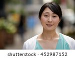 young asian woman in city smile ... | Shutterstock . vector #452987152