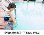 little asian girl sitting near... | Shutterstock . vector #453035962