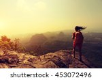 young woman backpacker hiking... | Shutterstock . vector #453072496