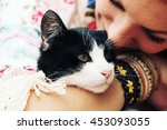 Stock photo young happy smiling red haired girl dressed in hippie bohemian style hugging cat outdoors 453093055