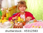 young girl sitting by easter table - stock photo