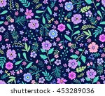 Stock vector vector seamless pattern cute pattern in small flower small lilac and purple flowers dark blue 453289036