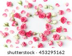 Stock photo framework from roses on white background flat lay 453295162
