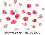 Stock photo assorted roses heads various soft roses and leaves scattered on a white background overhead view 453295222