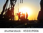 oil field oil workers at work | Shutterstock . vector #453319006