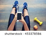 sporty girl using mobile phone... | Shutterstock . vector #453378586